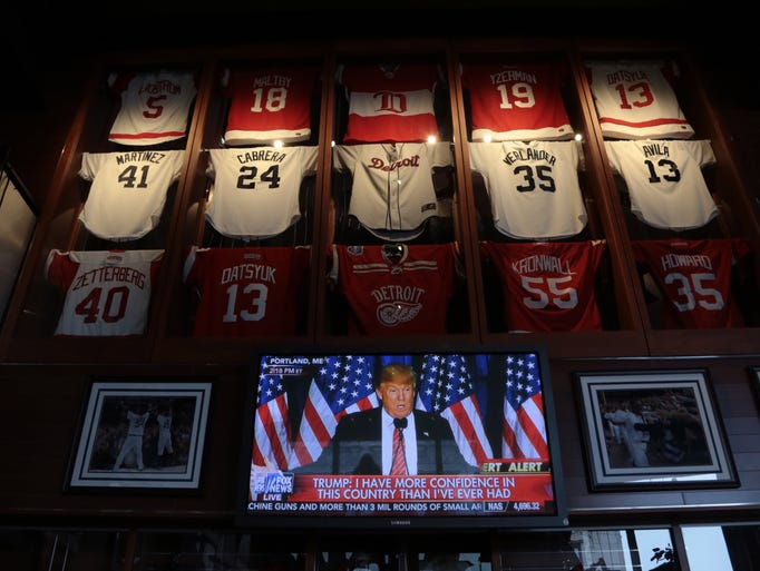 Donald Trump is seen speaking on television at Hockeytown