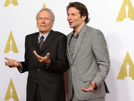 Director Clint Eastwood and actor Bradley Cooper arrive