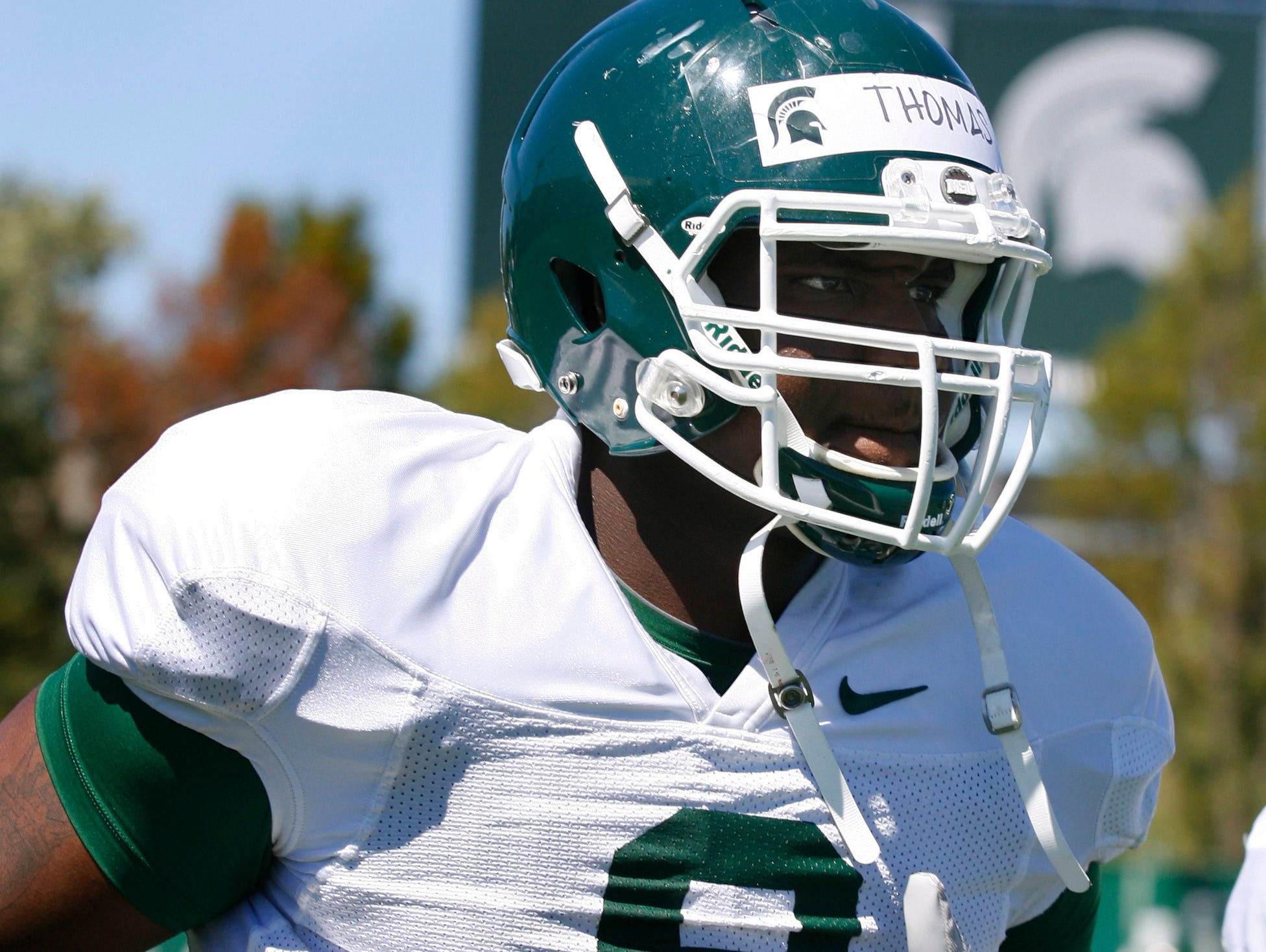 Michigan State's Lawrence Thomas runs a drill during practice last fall. He has moved to defensive end for his senior season.
