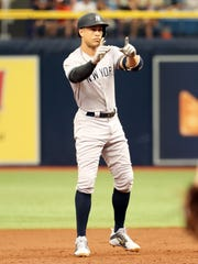 New York Yankees designated hitter Giancarlo Stanton (27) had five hits in Sunday's game.