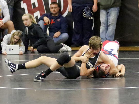 Corning's Drew Witham, top, on his way to a win by