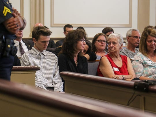 Tyler Hofstetter, brother, left, and Linda Hofstetter, mother,  center, of Travis Hofstetter, in court for his sentencing in State Superior Court, Morristown on June 27, 2016 for the murder of his father, James Hofstetter.
