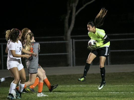 Mariner goalie Acelya Aydogmus catches a shot on goal