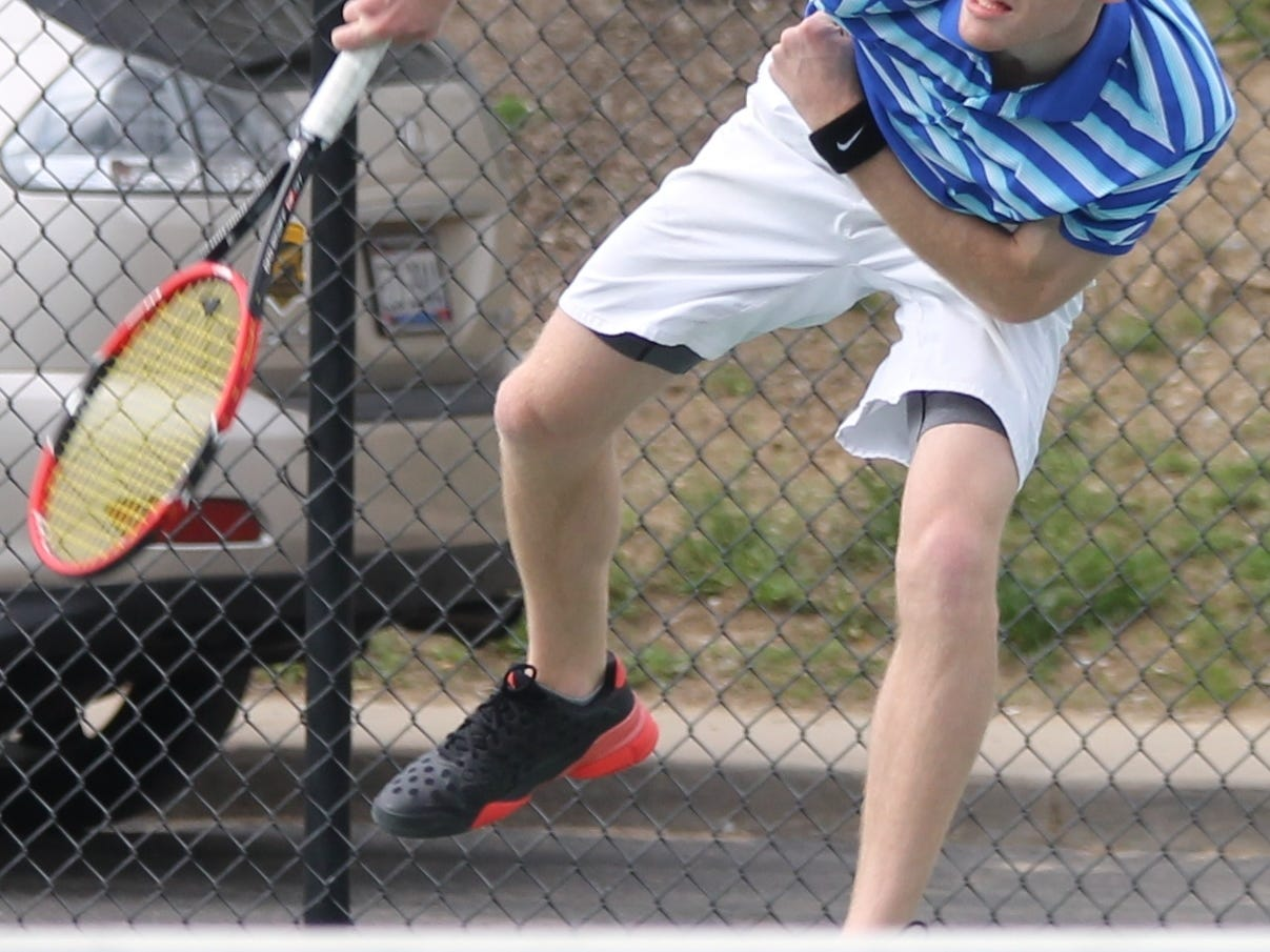 Summit Country Day's Calvin Spanbauer smacks a serve during his match at Seven Hills April 16.