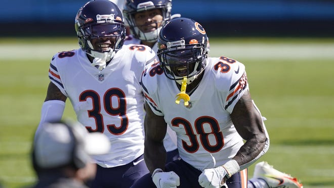 Chicago Bears strong safety Tashaun Gipson (38) reacts with free safety Eddie Jackson (39) following Gipson's interception against the Carolina Panthers during the first half Sunday in Charlotte, N.C.
