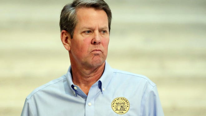 Georgia Gov. Brian Kemp walks away after speaking during a news conference at the Georgia state Capitol on Wednesday, April 8, 2020, in Atlanta.