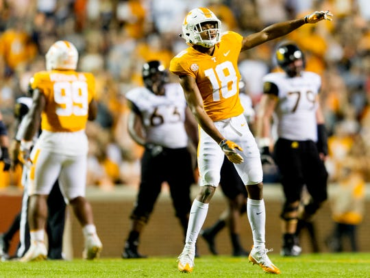 Tennessee defensive back Nigel Warrior (18) dances