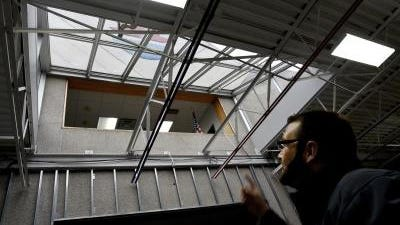 Mark Cochran, assistant to the City Manager and economic development doordinator of the City of Monroe, points out leaks in the skylight at The River Raisin National Battlefield Education and Visitor Center as construction has begun at the center.