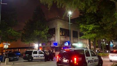 Lafayette Police officers stand near Shakers nightclub on Jefferson Street in a June file photo.