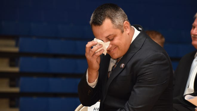 Dustin Weaver gets emotional while watching a video from staff, students and others during an assembly Thursday where Weaver was named the Ohio State Teacher of the Year.