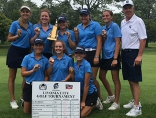 Stevenson's girls golf team poses with its trophy and