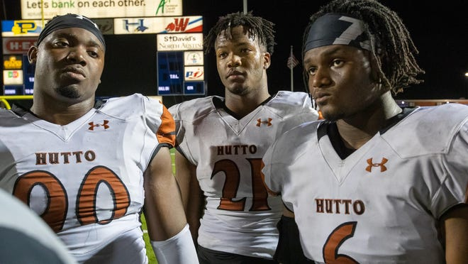 Hutto defensive linemen Landyn Watson, center, and Braylon Sugg, right, return as arguably the top pair of pass rushers in the Austin area.