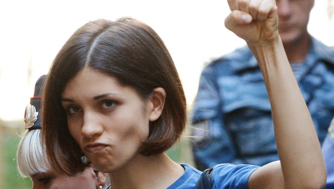 """Member of female punk band """"Pussy Riot"""" Nadezhda Tolokonnikova gestures before a court hearing in Moscow on Aug., 2012."""