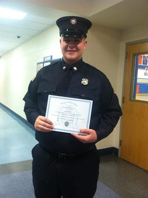 Cale Henry receives his training certificate from the Fire One course.