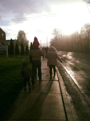 Despite chilly conditions and a little snow, a few walkers braved the cold for the first Community Walk April 9.