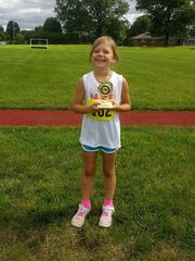Greencastle's Maelle Weir, 6, poses for a photo after completing the Fred Kaley Road Race 5-Miler on Aug. 5. Weir was planning on running the 5K race, but when Greencastle XC coach Rich Secrest joked to Weir about running the 5-Miler, she took it as a challenge and won the 19 & Under age group with a time of 59:16.