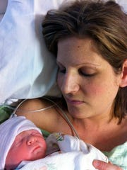 Liz Braatz welcomes her daughter Sydney to the world.