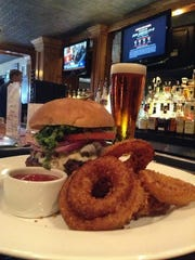A cheeseburger and onion rings at the American Hotel bar.