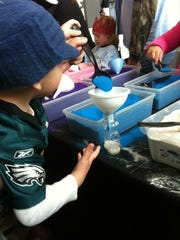 Chase Jackson of Brooklawn creates sand art at a previous prior Huddle Up for Autism event sponsored by the Philadelphia Eagles.
