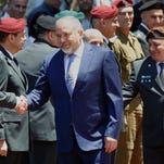 Israel's ultra-nationalist and newly appointed defense minister Avigdor Lieberman, center,  shake hands with military general staff in Tel Aviv on May 31.