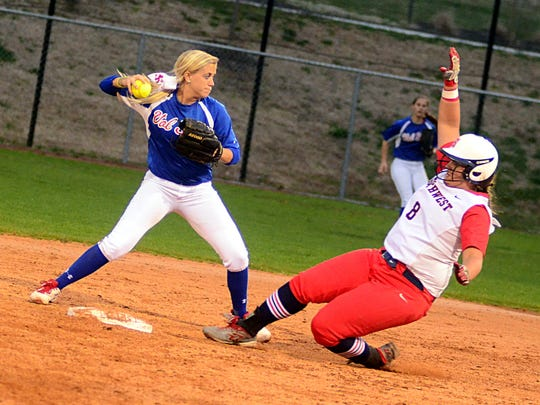 Volunteer State Community College sophomore second baseman Bethany Jacobs attempts to turn a double play as Southwest Tennessee sophomore Kayla Bryant slides in during the first game of Friday evening's doubleheader.