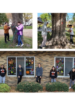 Top left: Hayden and Hana Zeig volunteered for FFA to help out with the Holiday Lights in Motion set-up at Sportsmen's park. Right: Marcus Martinez and Kyle Capacia stepped into action to help out with the Holiday Lights in Motion set-up wrapping lights around tree trunks. Bottom: This FFA officers crew painted windows on Saturday at the Sleepy Eye Care Center and Countryside Apartments, from left: Leisha Martinez, Morgan Hoffmann, McKenna Dockter, Nayzeth Luna, and Katelyn Capacia.