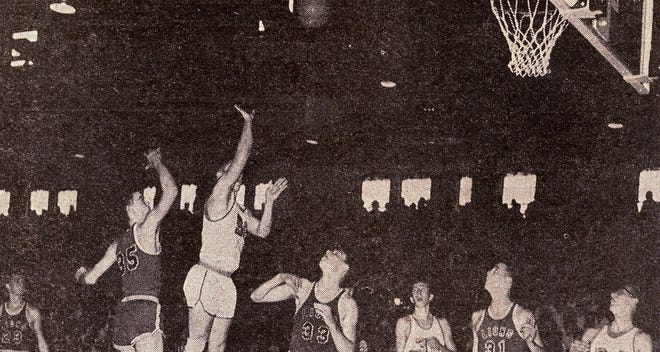 Swayzee's Burl Turner takes a shot during the fourth quarter during the Liberty Center 1964 regionals game, in Marion, which was later to go nine overtimes before Swayzee could win it, 65-61.  Rex Woodmansee (24) and Dave Pence (32) of Swayzee along with Dick Harris (35), Bruce Stanton (33) and Jim Harris (31) of Liberty Center wait on Turner's shot to hit or miss the goal.