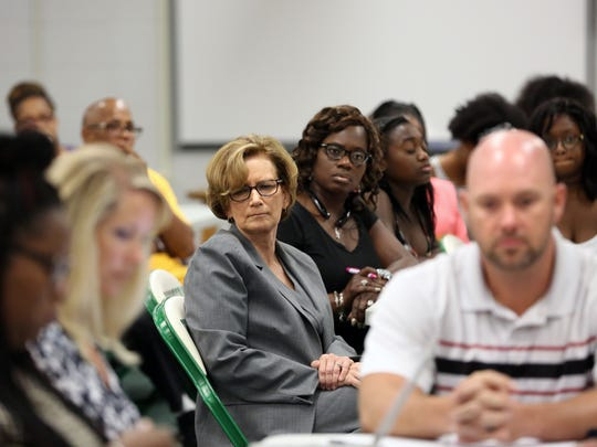 JCPS Superintendent Donna Hargins, center, listens to Butler's SBDM Council's meeting on dress code. 