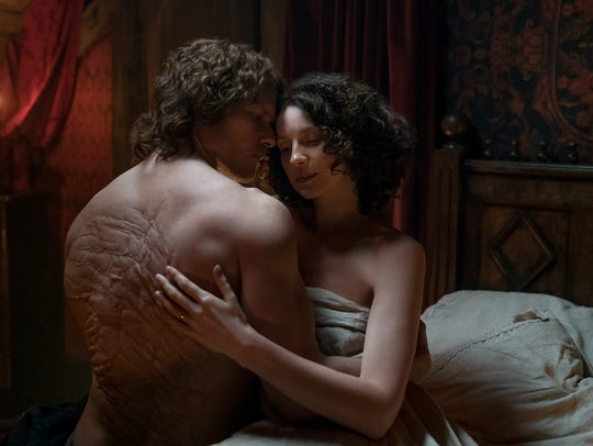 Claire Randall and Jamie Fraser's love story continues in North Carolina in Season 4. In this image from Season 3, Claire (played by Caitriona Balfe) caresses the back of Jamie (Sam Heughan).