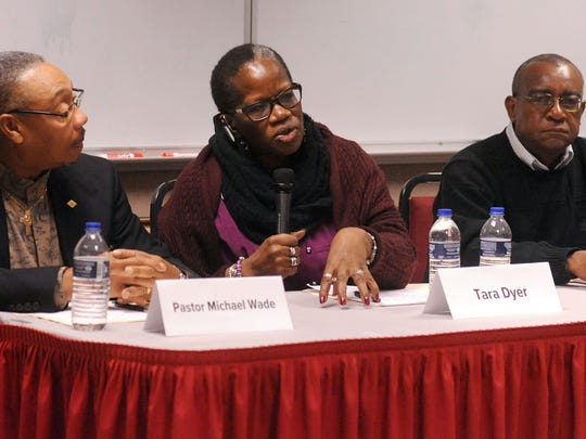 """Panelists, from left, Pastor Michael Wade, of True Faith Church of God in Christ; Tara Dyer, a retired Marion City Schools teacher; and Willie King, a youth mentor, talk and answer questions Wednesday about what it was like """"Growing Up Black in Marion,"""" a discussion held at The Ohio State University at Marion as part of the Black History Month celebration."""