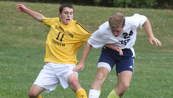 Clarkstown South's Zach Gloskin, left, fights for the