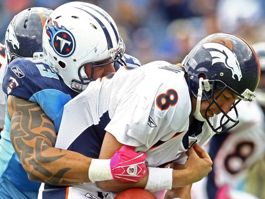 Tennessee Titans defensive end Jason Babin, left, sacks
