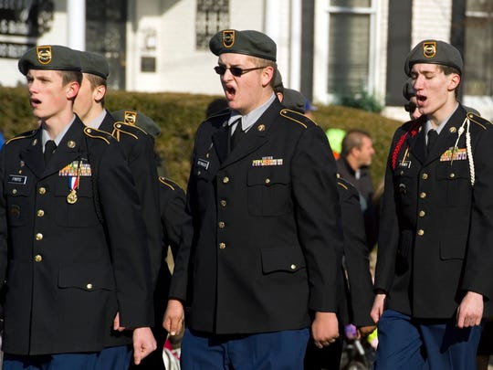 KEVIN SWANK / Gleaner file photo Henderson County JROTC members call out a cadence as they march down Main Street during the annual Christmas Parade in Henderson in 2015.
