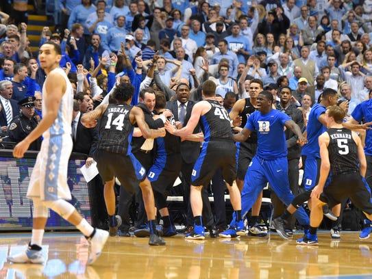 Duke Blue Devils players celebrate as North Carolina
