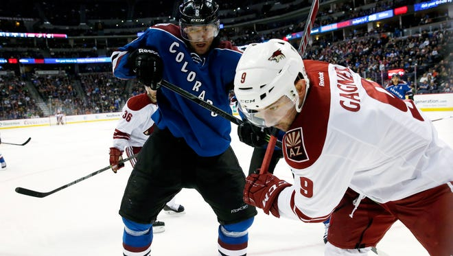Arizona Coyotes center Sam Gagner (front) battles for control of the puck in the corner with Colorado Avalanche defenseman Jan Hejda in the third period on Monday, Feb. 16, 2015, in Denver. Colorado won 5-2.