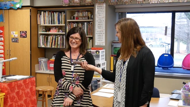 Stephanie Borlik (left) was interrupted in her second-grade classroom by Carmel Elementary Principal Megan Klinginsmith to hear she had won tickets to the Super Bowl through a United Way-Indianapolis Colts promotion.