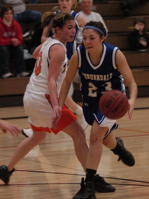 In this 2008 photo Kelly Tomfohrde of Auburndale drives past Iola-Scandinavia's Lizzy Nelson during at game against Iola.