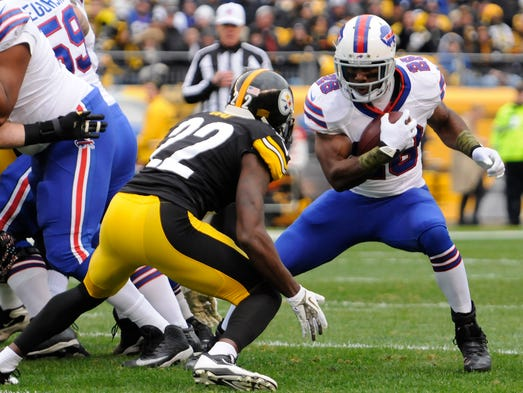 Nov 10, 2013; Pittsburgh, PA, USA; Buffalo Bills running back C.J. Spiller (28) runs with the ball as Pittsburgh Steelers cornerback William Gay (22) defends during the first quarter of a game at Heinz Field.