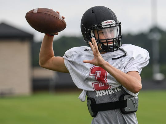 Liberty High School quarterback Carter Smith throws during practice at the school in July.