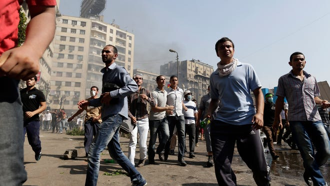 Supporters of Egypt's ousted President Mohammed Morsi clash with Egyptian security forces in Ramses Square, downtown Cairo, Egypt, on Friday.