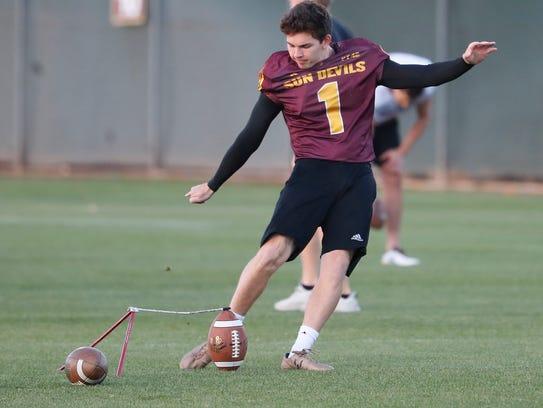 ASU's Brandon Ruiz (1) kicks field goals during a spring