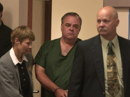 Gerald Carnahan is led into the courtroom for his arraignment in the1985  murder of Jackie Johns