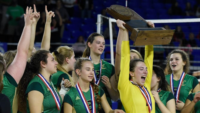 Catholic celebrates its Class AA Volleyball Championship win over Signal Mountain on Friday in Murfreesboro.