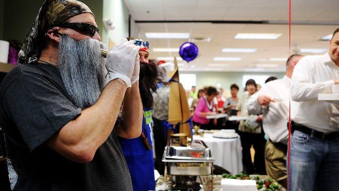 Jeff Anderson uses a duck call to attract people to his Jalapeno Quack Snacks Jack booth during the annual Gourmet Guys event last year.