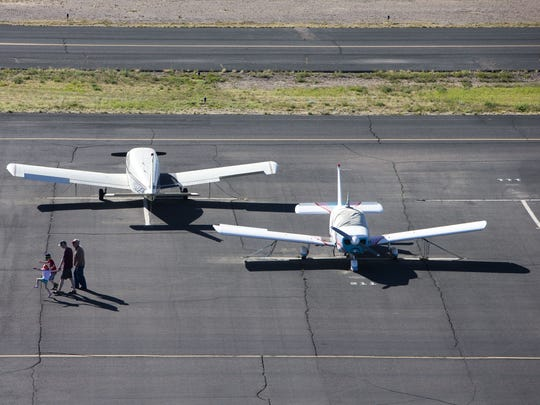 A family walks toward the flight hangers after their