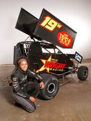 Driver Sara Elrod with her micro sprint car Tuesday, August 1, 2017, in Lafayette.