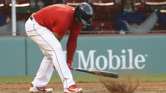 The Red Sox' Rafael Devers slams his bat in disgust after popping out in the sixth inning, failing to get a hit with runners on base in the first of two games against the Blue Jays on Friday.