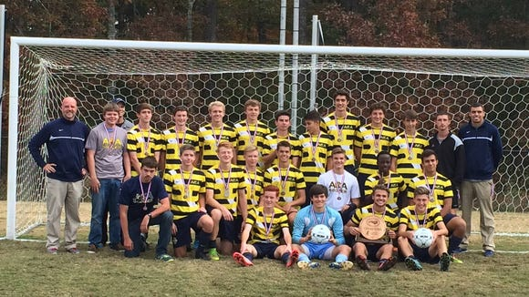 The victorious Asheville Christian Academy boys soccer team.