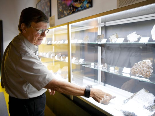 Don Cline discusses his meteorite collection on display