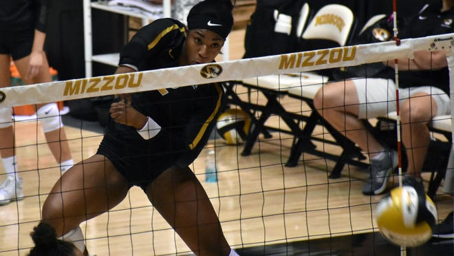 Missouri outside hitter Leketor Member-Meneh (2) looks at the ball she just spiked during the 2019 Black and Gold match at the Hearnes Center.